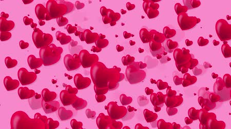 Many red and rose small hearts flying on a pink background. Valentines day motion background loop. Valentines Day holiday abstract loop animation