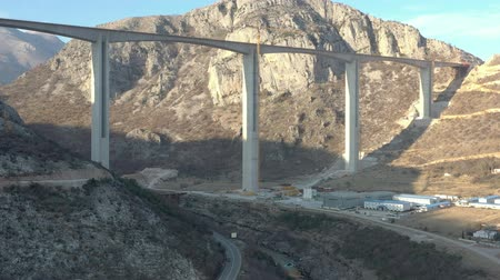 Aerial shooting of the construction of Montenegros first expressway. Autobahn highway between Montenegro and Serbia, which will connect the South and North of the country. Mountain bridge in the north of Montenegro and a deep canyon of the mountain river Stok Video