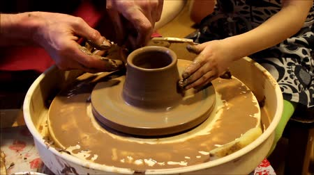 potter wheel : Creating a pot on a potters wheel.