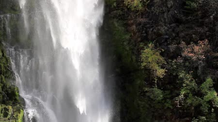 section of mill creek falls in Oregon with cascading water over the rock cliff