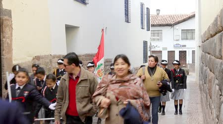 People in the streets of Peru rushing to get to the Plaza de Armas for the activities Stock mozgókép