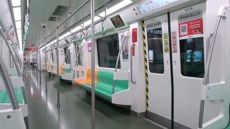 kolej : Xian City, February 24, 2020: Interior of Xian City subway train, wide angle view 4K Wideo