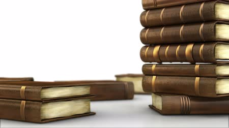 livros : Library table full of books isolated on white  Stock Footage