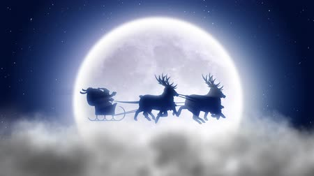 santa : Santa with reindeer flies over night Stock Footage