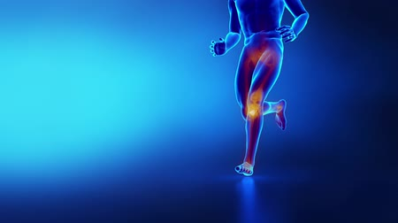 diz : Running man in x-ray - focused on knee  Stok Video