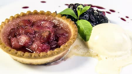 tartlet : Freshly baked rhubarb tartlet with honey ice cream and cherry coulis