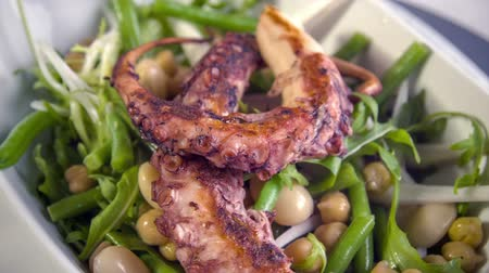 soğancık : Cold served chickpea-bean salad with shallot, freeze lettuce and rocket salad with warm grilled octopus