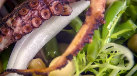 chalota : Cold served chickpea-bean salad with shallot, freeze lettuce and rocket salad with warm grilled octopus