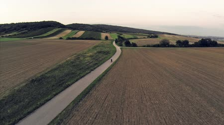 ridge line : Following biker and car aerial shot Stock Footage