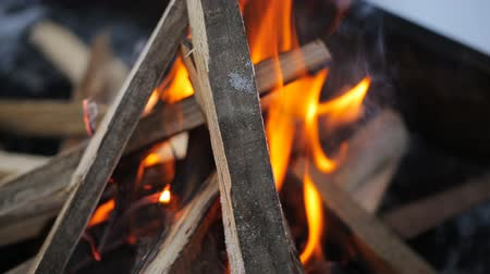 briquettes : Bonfire with a strong flame in form of a hut in which puts board in winter. Stock Footage