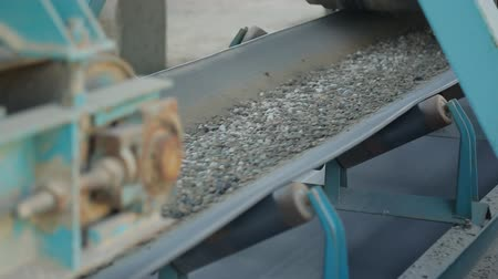 macadam : Belt conveyor moves various stone mixtures for further processing.