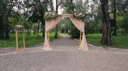 arche : Wooden arch with curtains for ceremony on wedding day outdoors Stock Footage