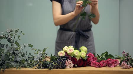 bouquets : Florist prepares cut fresh flowers for a mixed bouquet arranging.