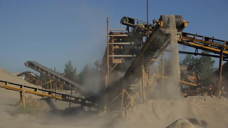 belting : At the plant at high conveyor moves the sand and drops down.