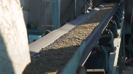 macadam : As the conveyor belt moves to the fine gravel factory floor. Stock Footage