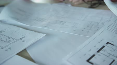 ügynökség : Close up papers with design drawings on meeting inside office.
