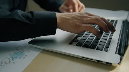 vstup : Close up of male hands typing text on laptop keyboard. Concept of: business people, laptop on desk, office table, keyboard button, hand typing keyboard