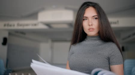 auditor : Beautiful female expert director auditor works with project standing in interior of company, portrait of successful chief businesswoman is looking, reading documents during working day in modern office. Concept: financial job, specialist, successful.