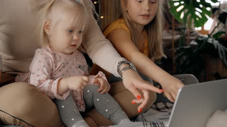 babysitter : Family mom and child two baby year watching video 4g tv in computer bed a comfort clothes. mother and happy young daughter kid room home see cinema in laptop. background babysitter in apartment. Concept woman, nanny or parent lifestyle Stock Footage