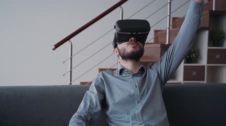 şifreleme : Enjoying of new digital technology. Innovation cyber concept of augmented futuristic virtual reality simulation. Interactive holographic game for smart people. Man is laughing and smiling making his best score. Stok Video