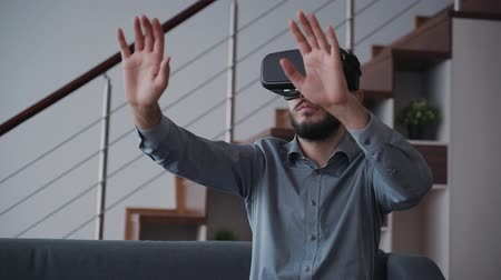 jel : New virtual simulation project for cyber gaming innovation and future business generation. American man is using digital technology of augmented reality and professional working device. Gesture motion interface.