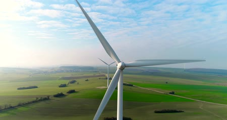 ветроэнергетики : Aerial drone view on Wind Power, Turbine, Windmill, Energy Production. Green technology, a clean and renewable energy solution Стоковые видеозаписи