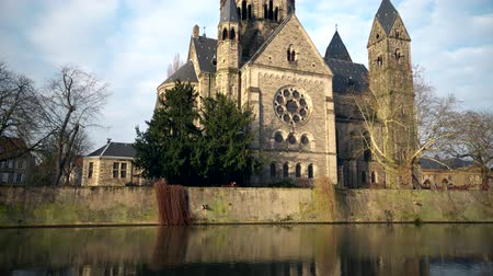 neuf : Scenic view of the neo-Romanesque Temple Neuf church in Metz, situated on an island in the Moselle river. Stock Footage