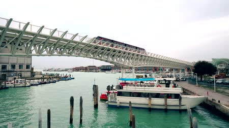 mono : Monorail train in Venice port. Tronchetto island, Piazzale Roma traffic of water taxi with tourist 4K