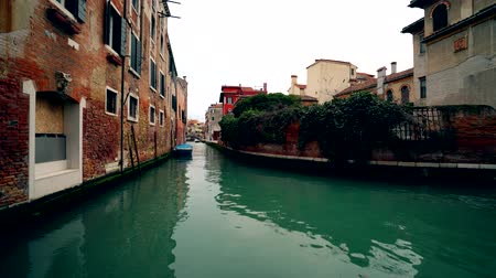 Venice Italy canal with no traffic green water and old houses 4K Wideo
