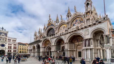 Timelapse of Campanile di San Marco and Palazzo Ducale Doges Palace in Venice, Italy. Columns of San Marco and San Todaro. Blue cloudy sky at 4K