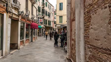 VENICE, ITALY - FEBRUARY 15, 2018: Tourists traffic of narrow streets in Venice, Italy Timelapse 4K