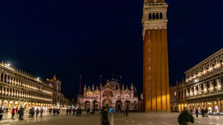 Piazza San Marco and Basilica of St Mark night timelapse. It is cathedral church of Roman Catholic Archdiocese of Venice. Tourists walking in front of it. 4K