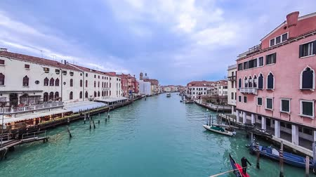 Gondolas and boats traffic in Venice timelapse, Grand Canal panoramic view. Boat station. Blue cloudy sky at summer day