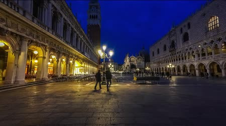 venetian lagoon : Piazza San Marco and Basilica of St Mark night timelapse. Cathedral church of Roman Catholic Archdiocese of Venice. Tourists walking in front of it. 4K