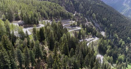 slovinsko : Aerial view of mountain serpentine road with trucks and cars driving on zig zag go up and down in Europe Switzerland 4K Dostupné videozáznamy