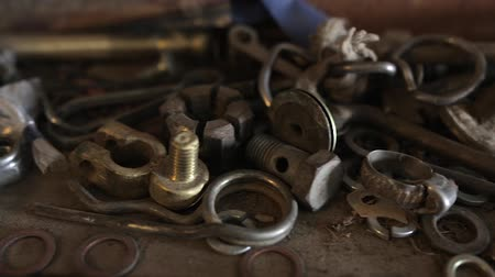 fasteners : Chaotic nuts, bolts and tools piled in a workshop