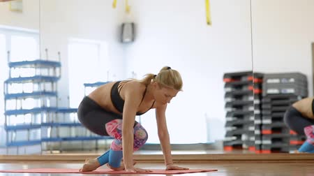 Yoga woman executing a sequence flow in a studio