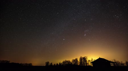 Time lapse of Milky Way moving over a barn in the countryside, in 4k