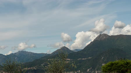 bellagio : Timelaps, Lake Como on a background of villages in the mountains and blue sky with cirrus clouds quickly move across the sky. 4k