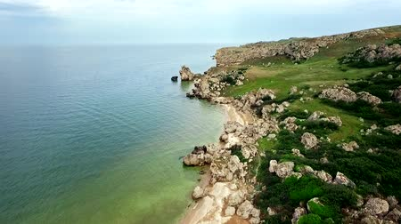 Aerial View: Flight over the сoast of thousands bays on General beach with shells and rocks near Kerch, Crimea. 動画素材