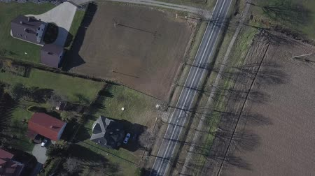 Birds-eye view of the motorway with moving cars. Panorama of a rural landscape. Shooting from the drone the movement of vehicles on an asphalt road. Monitoring of public safety. Navigation over Stock Footage