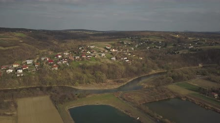 típico : Panorama from a birds eye view. Central Europe: The Polish village is located among the green hills. Temperate climate. Flight drones or quadrocopter. Urbanization of the landscape