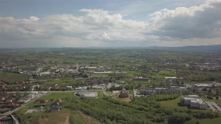 típico : Panorama from a birds eye view. Central Europe: town or village is located among the green hills. Temperate climate. Flight drones or quadrocopter on the industrial area. Near Jaslo town of Polish Stock Footage