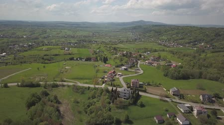 típico : Panorama from a birds eye view. Central Europe: town or village is located among the green hills. Temperate climate. Flight drones or quadrocopter. Near Jaslo town of Polish. Beautiful paradise
