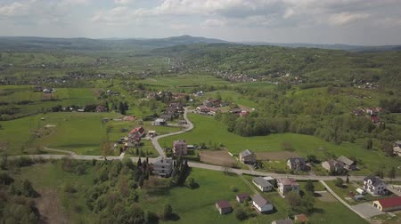 rural area : Panorama from a birds eye view. Central Europe: town or village is located among the green hills. Temperate climate. Flight drones or quadrocopter. Near Jaslo town of Polish. Beautiful paradise