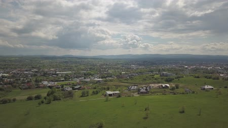 Panorama from a birds eye view. Central Europe: town or village is located among the green hills. Temperate climate. Flight drones or quadrocopter. Near Jaslo town of Polish. Beautiful paradise