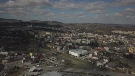 poland : Gorlice, Poland - 4 5 2019: Panorama of the historic center of the European medieval city on the picturesque green hills. Trips to architectural monuments, temples, quarters and sports complex MOSiR