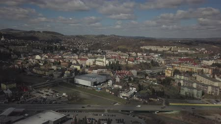 Gorlice, Poland - 4 5 2019: Panorama of the historic center of the European medieval city on the picturesque green hills. Trips to architectural monuments, temples, quarters and sports complex MOSiR