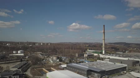 Gorlice, Poland - 4 5 2019: Industrial region of the Carpathian city. Top view of the refinery and auxiliary buildings. Video shot by drone or quadrocopter. Vanity of the day at the factory.
