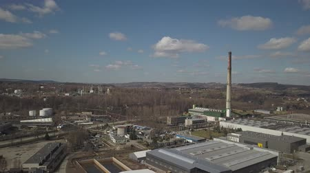 タンカー : Gorlice, Poland - 4 5 2019: Industrial region of the Carpathian city. Top view of the refinery and auxiliary buildings. Video shot by drone or quadrocopter. Vanity of the day at the factory.